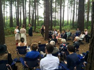 Outdoor woodland wedding ceremony celebrant
