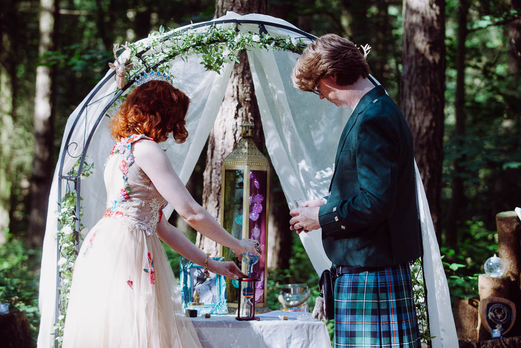 Woodland wedding and out door celebrant ceremony at Glamping Venue Camp Katur in Yorkshire Sand Ceremony